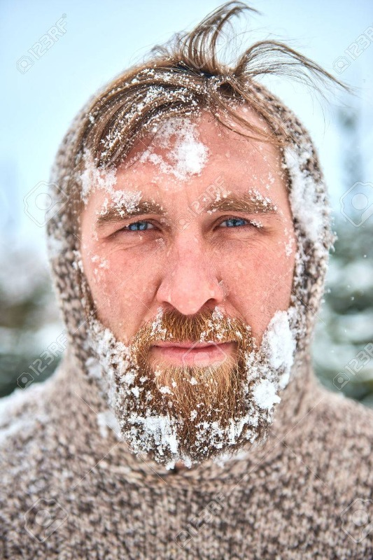 55228830-portrait-of-bearded-man-with-snow-on-his-face-man-is-frozen-in-pullover-with-hood-and-flying-hair-.jpg